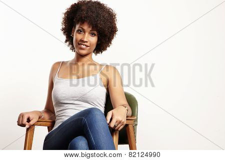 Black Woman With Afra Sitting In Na Chair