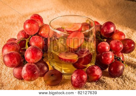 grapes and grape juice in a glass