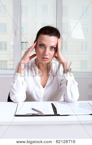 Woman On The Workplace Head Touches Her Hands Because She Had A Headache