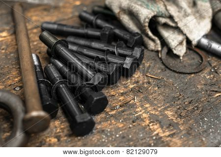 Black bolts on grungy table