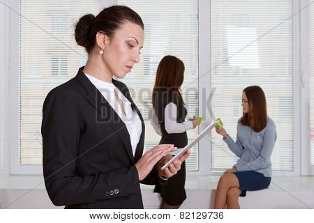 Woman In Formal Clothes Reading Information From The Tablet
