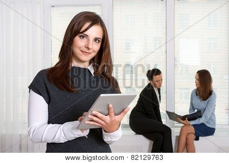 Secretary Smiling Girl Reads The Information From The Tablet