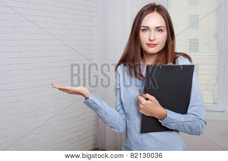 Girl Holding A Folder Expressing Bewilderment