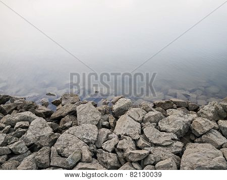 Rocky Dam on River Background