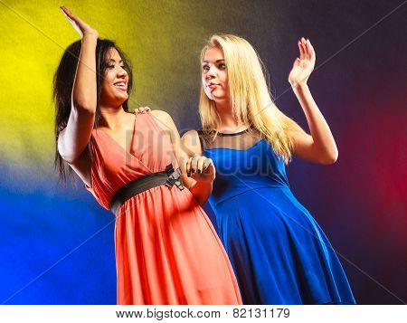 Two Funny Women Making Hands High Five In Dresses.