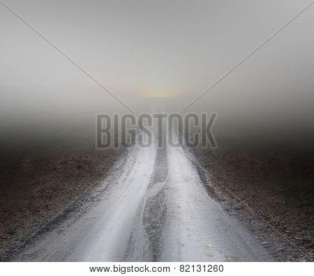 Dirt Road In Fog