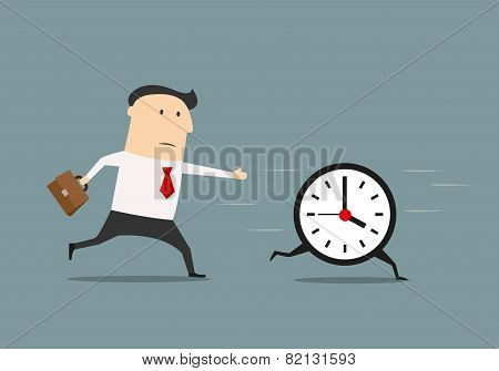 Businessman chasing a running clock