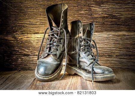 Pair Of Old Boots On Wooden Floor Boards