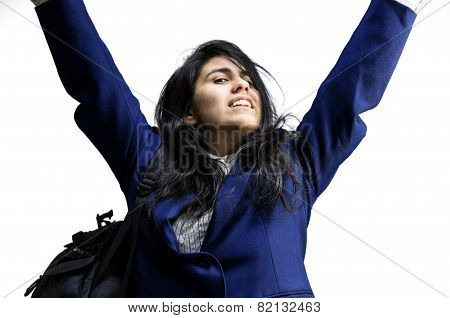 Happy latina teen girl with arms raised