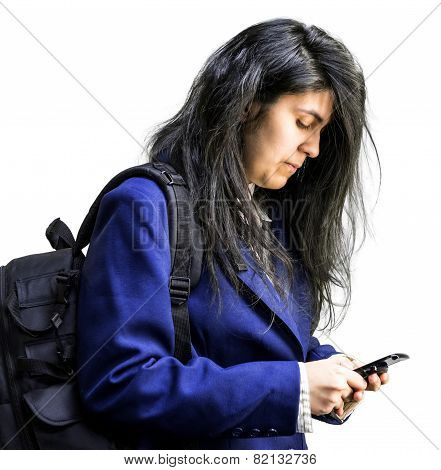 Latina teen girl looking down at cell phone