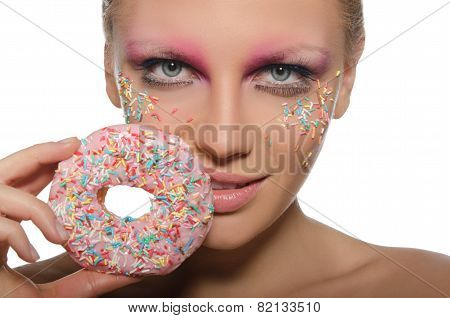 Beautiful Young Woman With Donut In Mouth