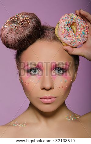 Young Woman With Two Donuts On Head