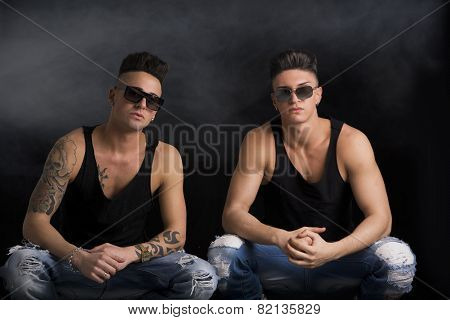 Two hip trendy male friends in studio shot