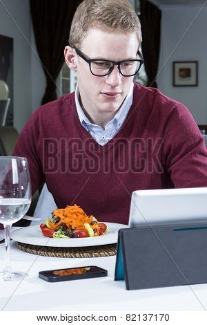 Young Businessman Working At A Restaurant.