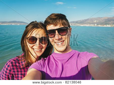 Happy Couple In Love Taking Self-portrait On Beach