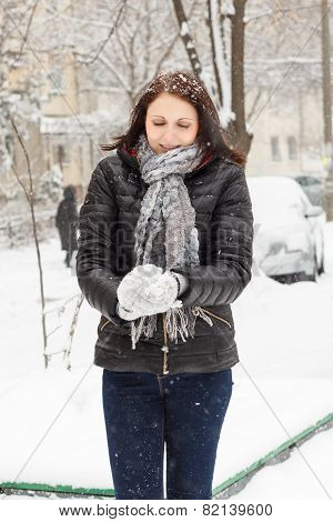 Girl Molds A Snowball