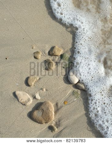 Stones On Sand And Motion Blurry Wave