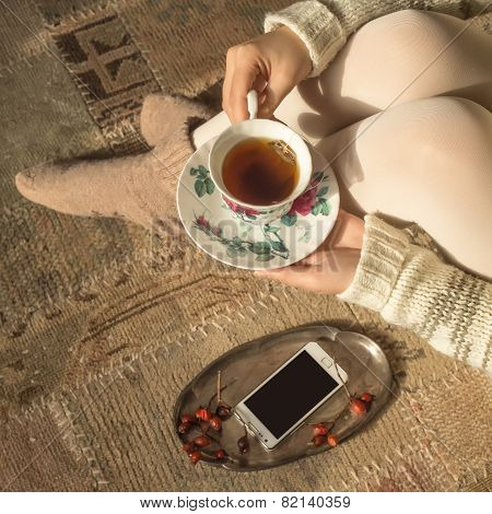 Woman Holding Vintage Cup Of Tea