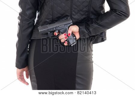 Sexy Woman Hiding Gun Behind Her Back Isolated On White