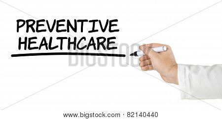 Hand with pen writing Preventive Healthcare