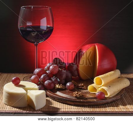Refined Still Life Of Wine, Cheese And Grapes