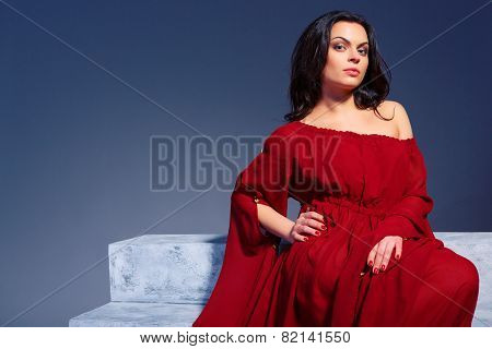Beautiful young woman in marsala summer dress