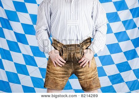 Bavarian man with brown Oktoberfest leather pants (Lederhose).
