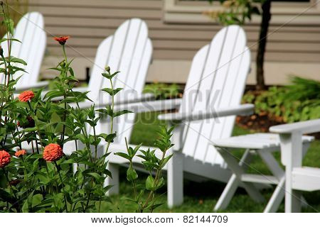 White Adirondack chairs in the garden