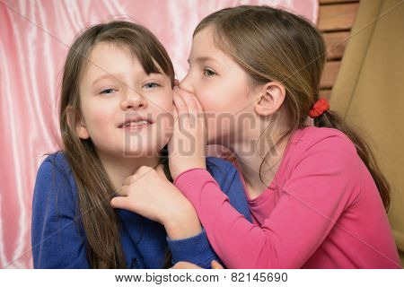 Two Little Girls Whispering Together