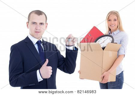 Moving Day Concept - Business Man Giving Key To Woman With Cardboard Box Isolated On White