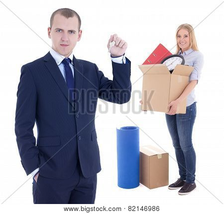 Moving Day Concept - Businessman Real Estate Agent Giving Key To Woman With Cardboard Box Isolated O