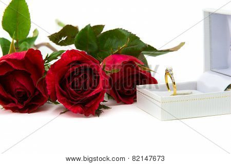 Beautiful red rose with beautiful diamond ring.