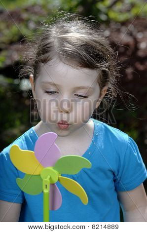 Girl Plays With Windmill