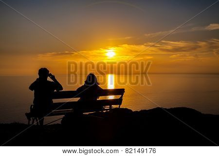 Couple Taking A Shot Of A Sunset