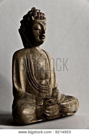 A wooden buddha statue