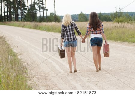 Blonde And Brunette Friends On Road Back View