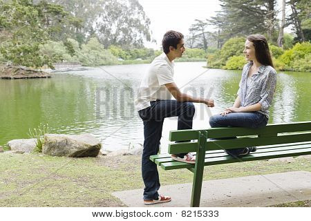 Teens On Park Bench