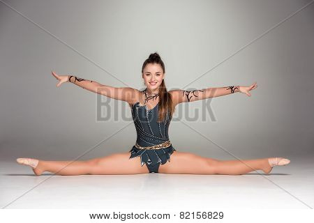 portrait of a gymnast stretching twine