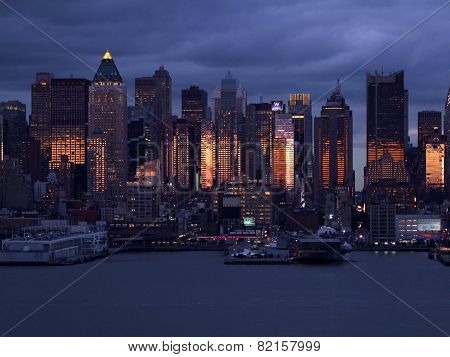 Silhouette Of Lower Manhattan At Night Sky Background