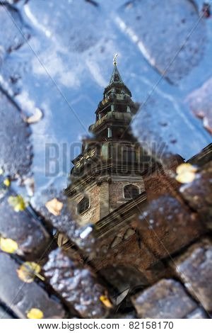 The Dome Cathedral In Riga In Autumn Puddle Reflection