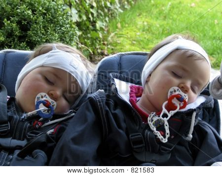 sleeping twins in the baby carriage 02