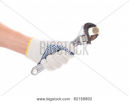 Hand holding adjustable wrench.