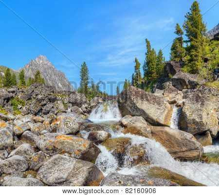 Small Cascade Of Waterfalls On A Mountain Creek