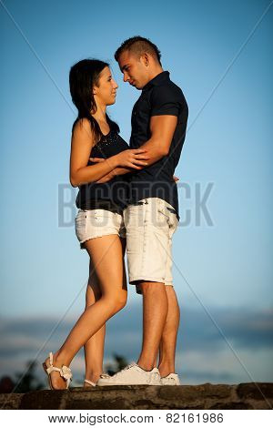 Teenage Couple On A Late Summer Afternoon In Park