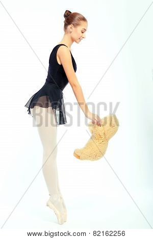 Beautiful ballet dancer on white background