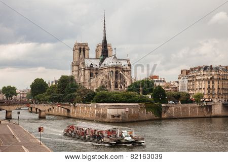 Notre Dame With  Tourist Boat On Seine In Paris