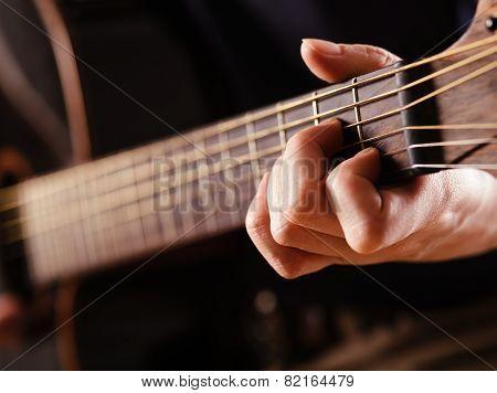 Playing Acoustic Guitar Closeup