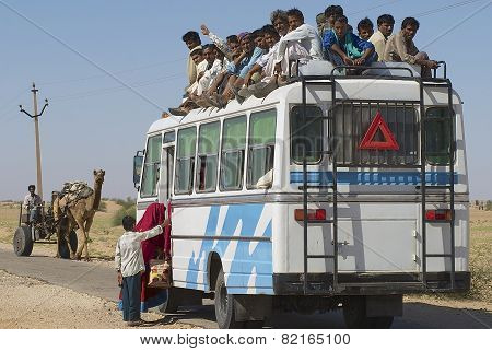 People enter the bus in Jamba, India.