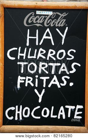Churros and chocolate sign.