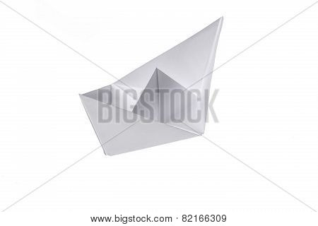 Folded Ship, Made Out Of Paper On A White Background